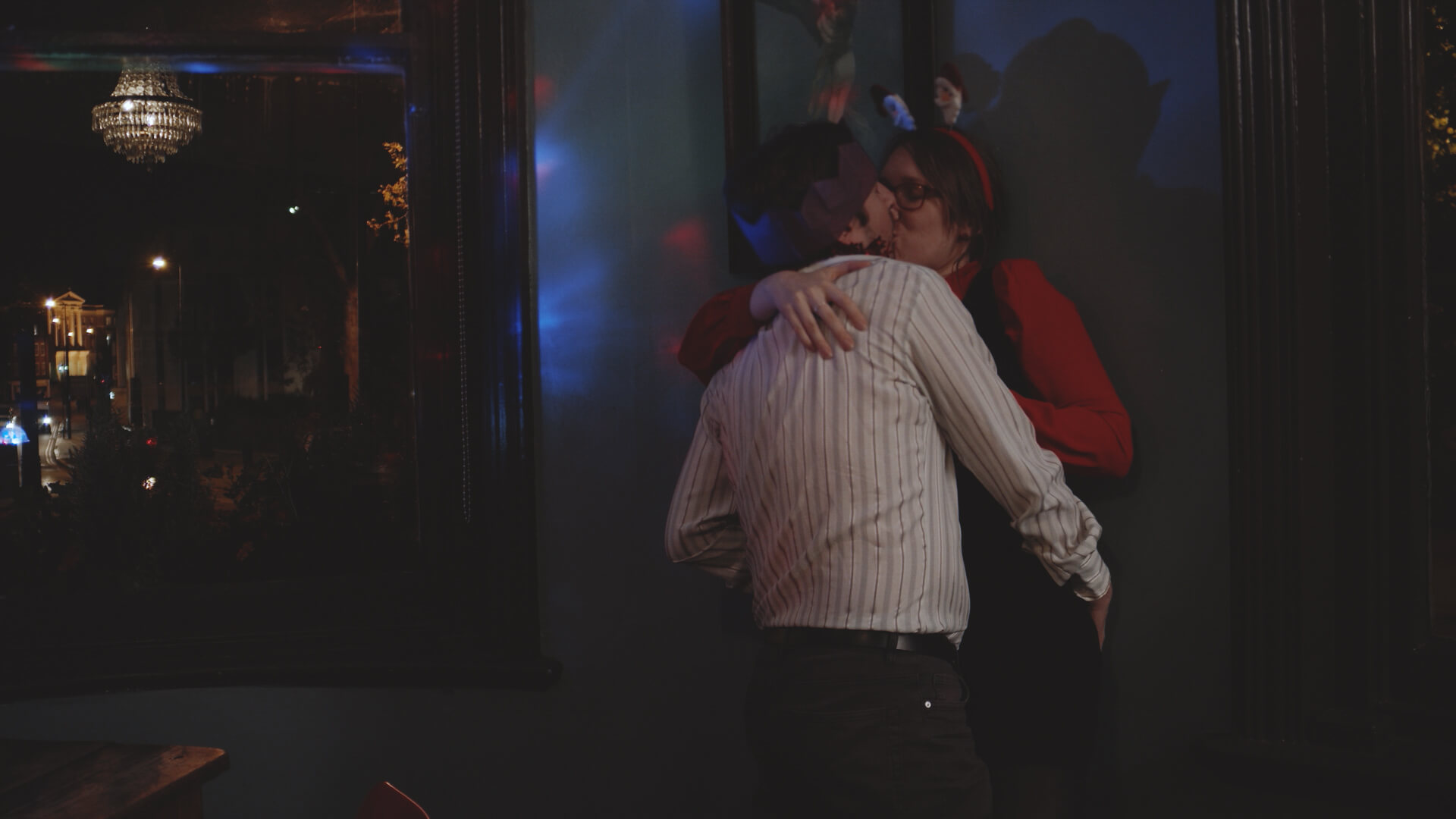 A couple snogging at the City Night's Office Christmas Party